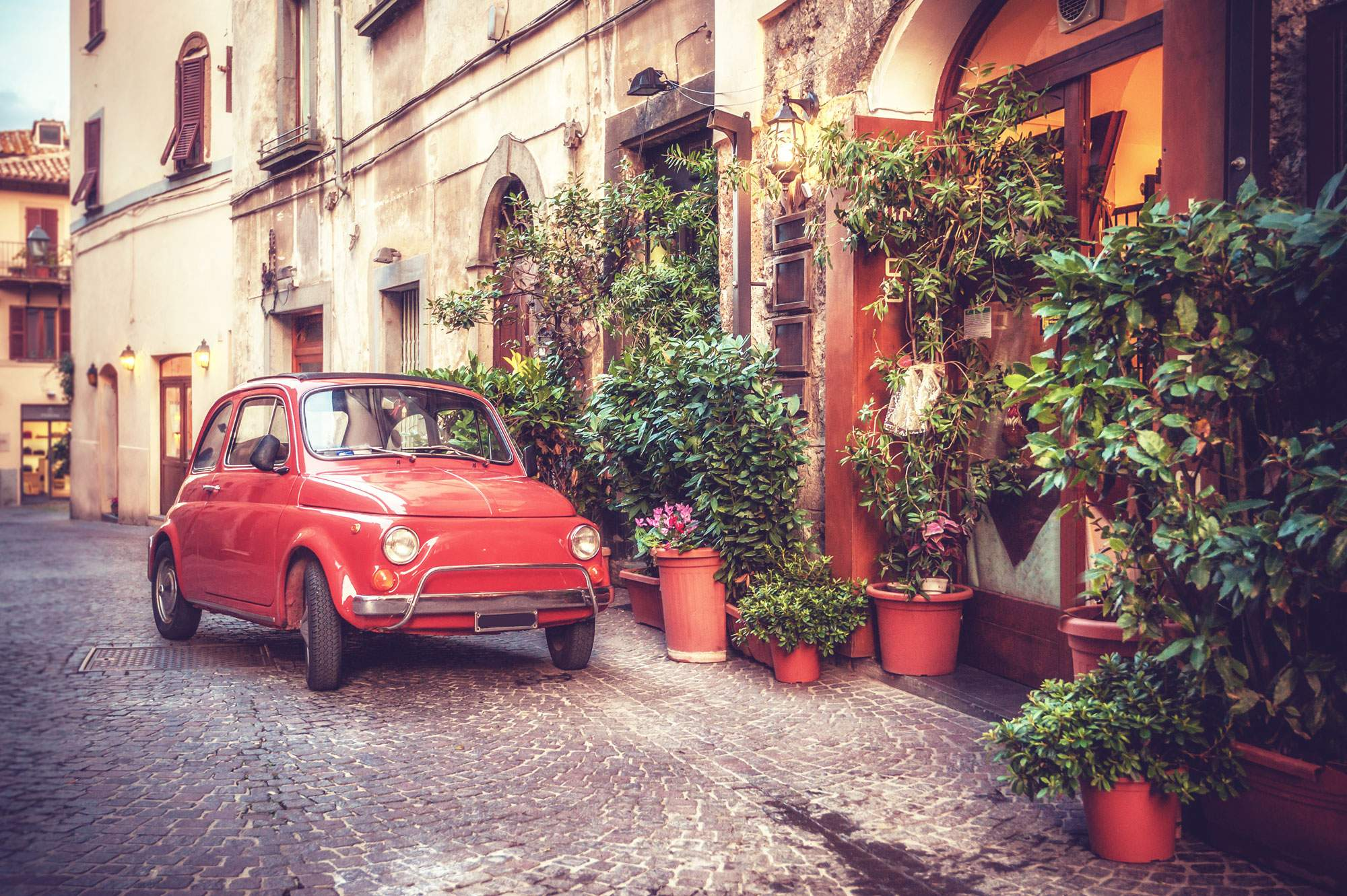 italy-roadtrip-driving-old-car-town-road